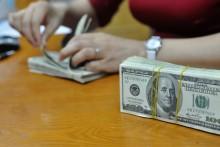 Ngân hàng ngoại dự báo cuối năm tỷ giá có thể vượt 22.000 đồng